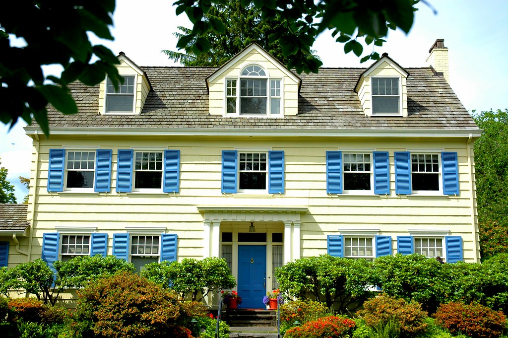 Three gables, 10 windows, blue shutters, yellow house in Washington Park neighborhood, Seattle, Washington, USA